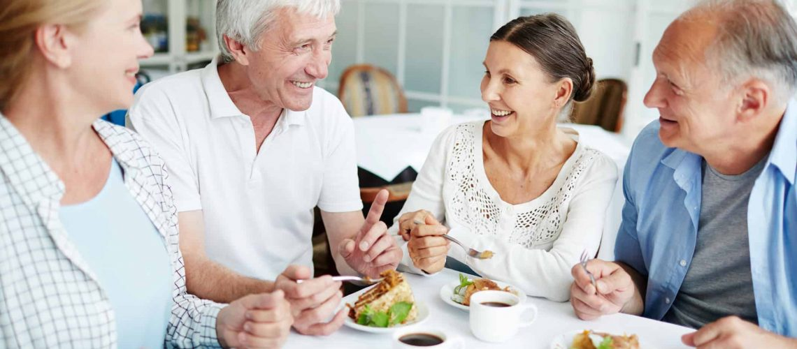 Treating your hearing loss helps you be more able to enjoy conversation over dessert with friends.